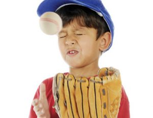 Child getting hit by baseball